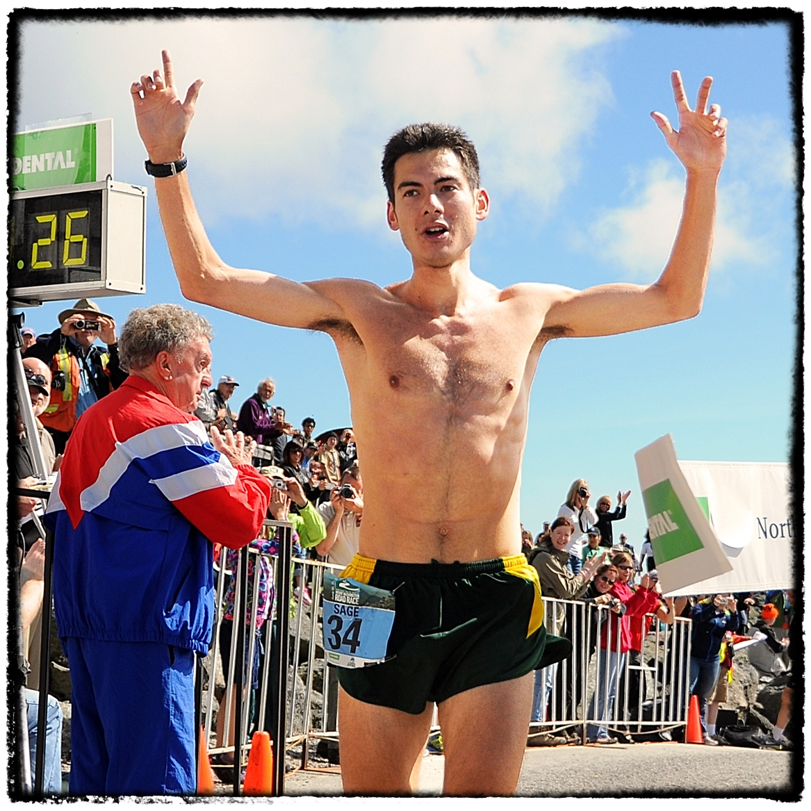 Sage Canaday, of Boulder, raises his hands in victory, after winning the 52nd running of The Northeast Delta Dental Mount Washington Road Race, with an official time of 58:27, in Pinkham Notch, NH, on June 16th, 2012. 1,200 runners raced up the 7.6 mile Mo