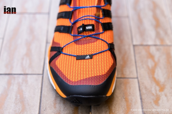 The upper has the classic Adidas  three-stripes  on the sides and these  also act as the lace-loops from which one pulls the lacing tight. 6210f8881